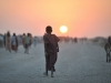 a-somali-girl-walks-down-a-road-at-sunset-in-an-idp-camp-near-the-town-of-jowhar
