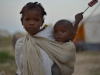 a-young-girl-with-her-baby-brother-in-an-idp-camp-near-the-town-of-jowhar-somalia_0