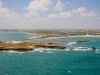 A panoramic aerial view shot from over the Indian Ocean of the southern Somali port city of Kismayo. STUART PRICE.
