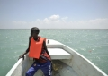 A young lifeguard keeps an eye out for swimmers in distress while patrolling off of Lido beach in Mogadishu, Somalia, on January 31. The Mogadishu lifeguards, consisting entirely of a volunteer force of fisherman, began patrolling Lido beach in September 2013 after a spate of drownings. Mogadishu's beaches have become a popular destination for the city's residents since al Shabab withdrew the majority of its militants from the city in 2011. AU UN IST PHOTO / Tobin Jones