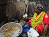 a-woman-cooks-samosas-on-a-small-stove-at-a-market-in-mogadishu-somalia-during-the-holy-month-of-ramadan-on-july-11-ilyas-a-abukar