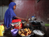 a-young-woman-cooks-samosas-on-a-small-stove-at-a-market-in-mogadishu-somalia-during-the-holy-month-of-ramadan-on-july-11-ilyas-a-abukar