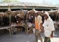 two-men-seen-walking-past-main-hudur-grocery-market-capital-city-of-bakol-somalia-mohamud-hassan