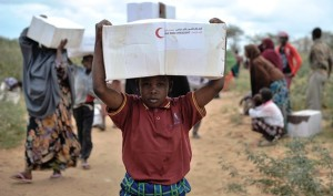 A young boy carries away a box of food from a food distribution center in Afgoye, Somalia, on August 4th. The U.A.E Red Crescent gave out food aid as part of a program they are conducting during the month of Ramadan. Over 5,000 IDPs were given food during the NGO's trip to Afgoye, which was aided in part my AMISOM forces. AU UN IST PHOTO / TOBIN JONES.