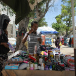 A woman and young girl buy products at a roadside stall in Hamar Weyne market in the Somali capital Mogadishu,