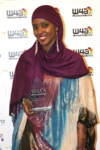 Ifrah Ahmed accepting the Women4Africa Humanitarian of the Year Award in London, England.